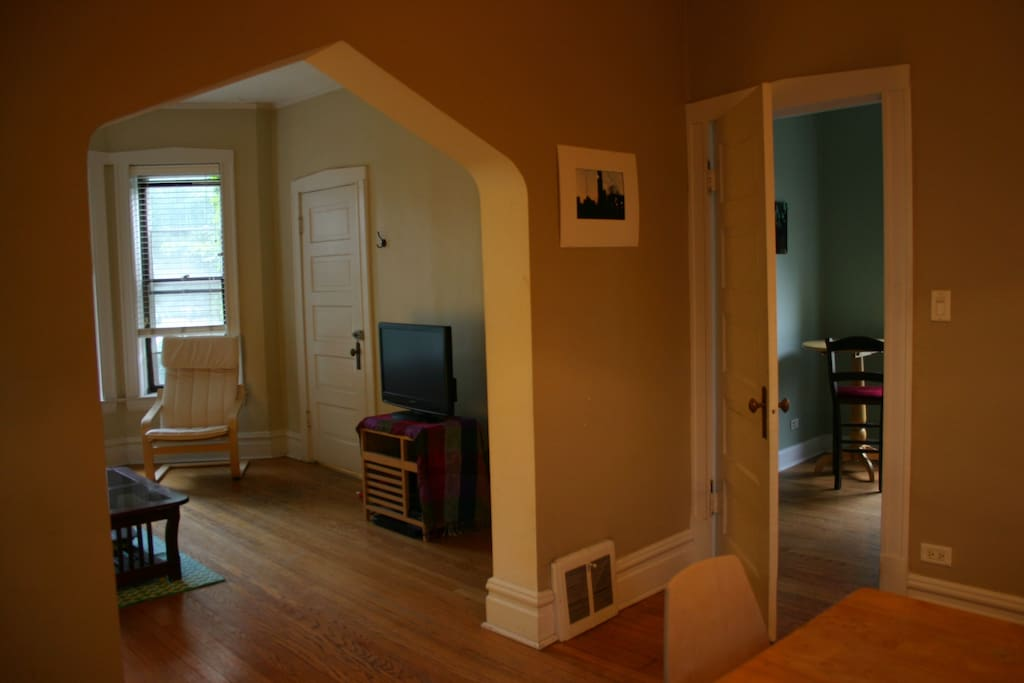Picture taken from the dining room, living room is to the left and smaller bedroom through the door to the right
