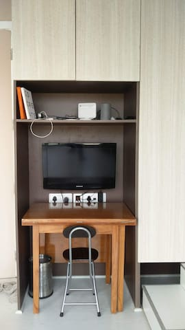 Books + TV + Study table - that opens into a 4 seater dining table