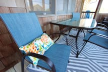 Outdoor seating on screened porch