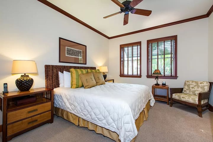 Master Bedroom with a queen size bed.