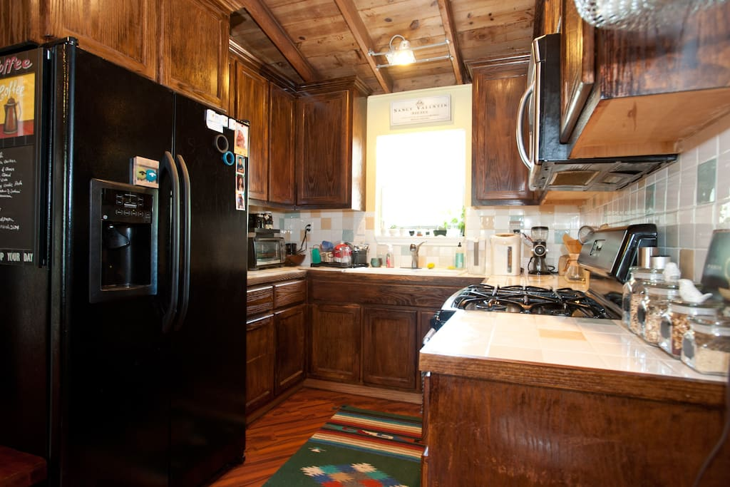 Front House: Kitchen - feel free to use anything in the kitchen! Utensils, Pots and Pans, Bowls, Plates and Mugs at your fingertips.