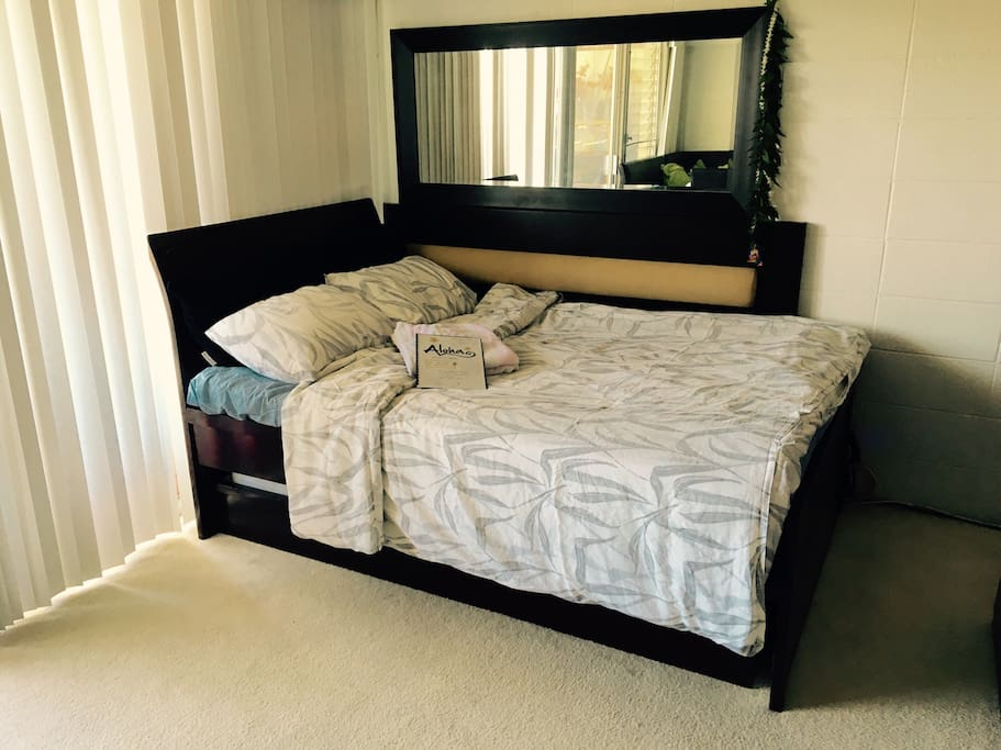 The bed has a temperapeudic mattress for your ultimate comfort. The frame also has a trundle bed beneath if you need additional mattress!