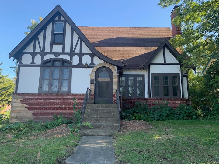 1930s Tudor Style House- In Town Location!