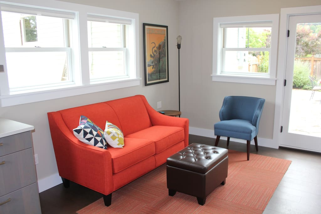 The living space bursts with natural light and cheerful color.