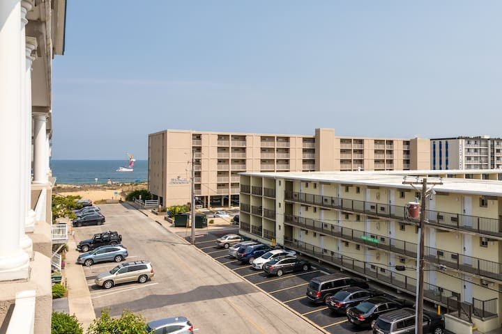 Ocean & bay view condo w/ fireplace, less than a block to the beach!