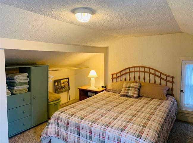 Upstairs bedroom. Perfect for a couple, or the couple with kids, as there are two floor window bunks that are cute as a button!