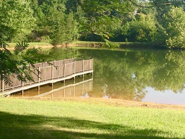 Lush surroundings. Dock goes out onto the pond.