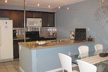 fully equipped kitchen w/open concept dining area