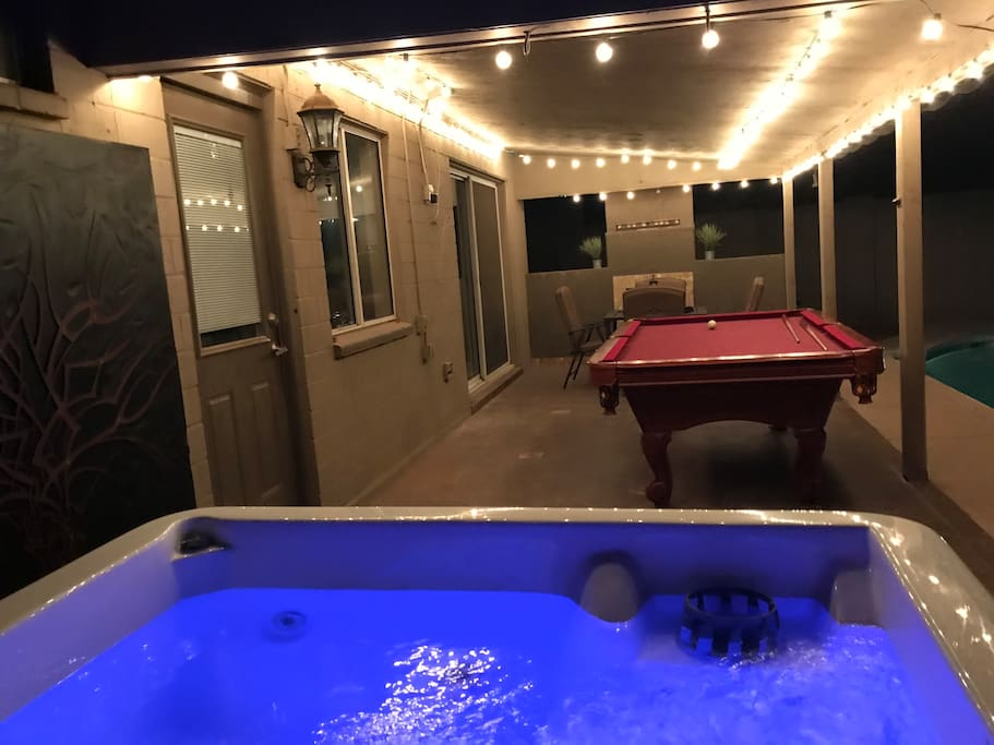 Hot tub with jets, pool table, dart board, bags (aka corn hole) and lounge area
