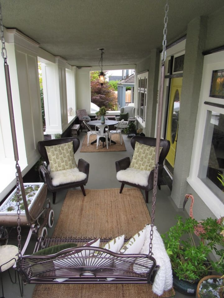 Front porch of the manor that is a common are for all guests to utilize and enjoy to mingle with other guests, relax, read a book, or just enjoy.
