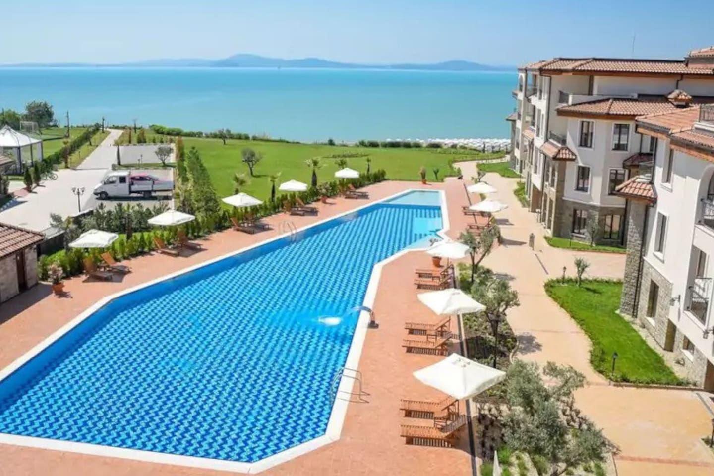Sea front, clean sandy beach, 50 meters swimming pool and a separate pool for kids. Nice restaurant nest to the apartment complex.