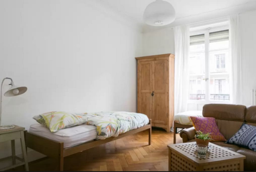 spacious bedroom with single bed out