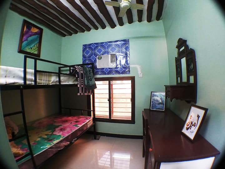 A comfy room with a bunk bed for two in Stone Town