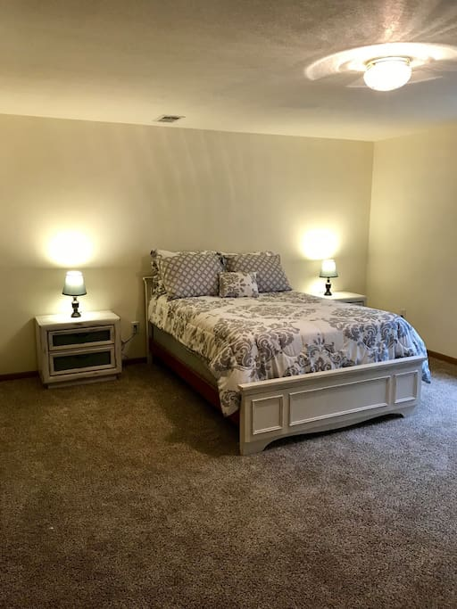 Open room with comfortable bed