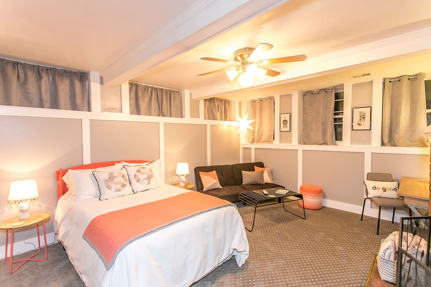 Bedroom/Living Room Area with a Full Size Bed and Futon