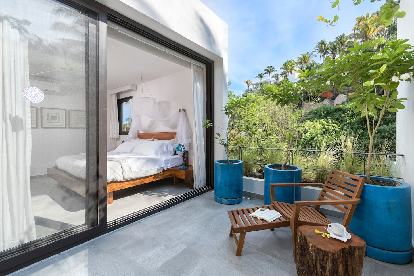 Top Suite with private terrace area, overlooking other million dollar homes, and jungle, trees, birds.