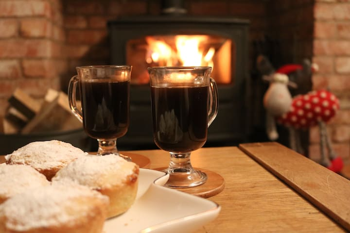 Enjoy a glass of something warming in front of the wood burner in our cosy lounge.
