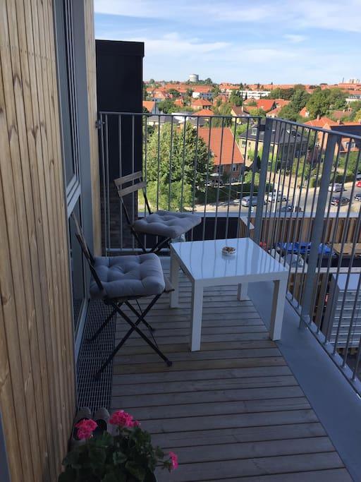 Small balcony next to entrance