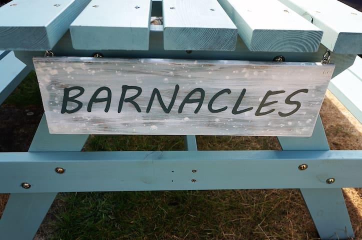 'Barnacles' - host made plaque on our picnic bench to welcome you!
