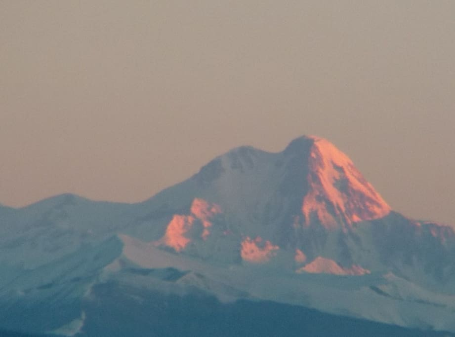 March 6, 7:30 a.m. Mount Kazbek (5047m) just in front of you (100 km from your window)! Looks like you can spot the climber over there... Oh, no... It is just my imagination ((