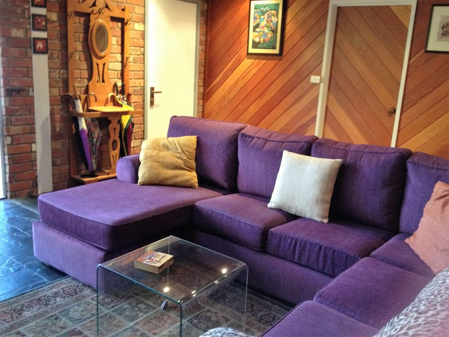 comfortable and ample lounge with views of the back garden