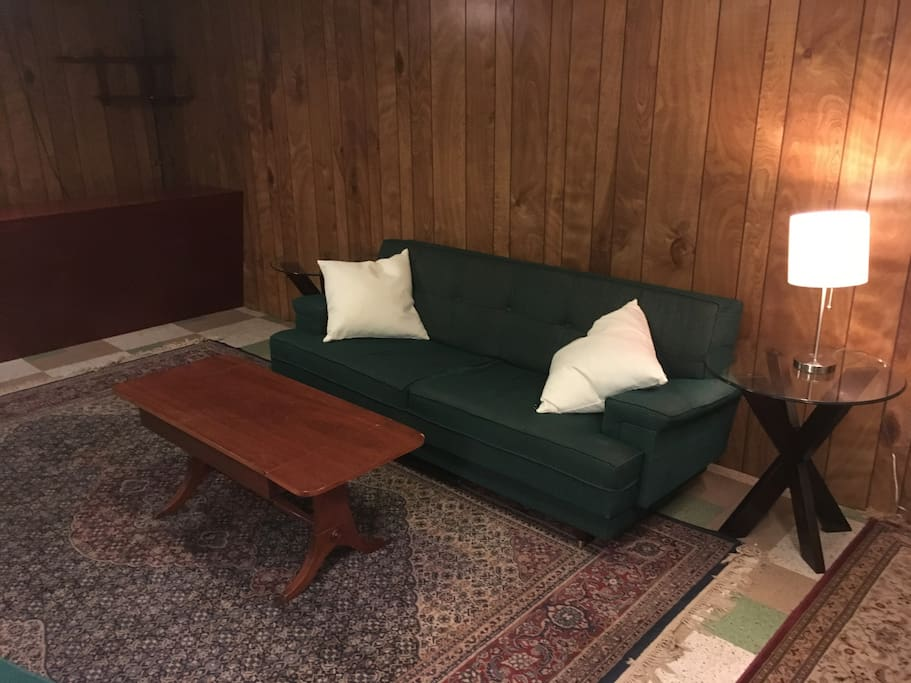 Couch, throw pillows, coffee table, side tables and lamp.