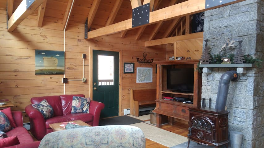 Open loft area with comfortable seating and wood stove
