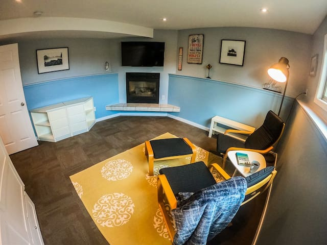 """This room has everything you need, relaxing seating area to enjoy your coffee and a favourite book.  A 50"""" TV for watching your favourite shows, and a gas fireplace for the Fall and Winter seasons to warm up."""
