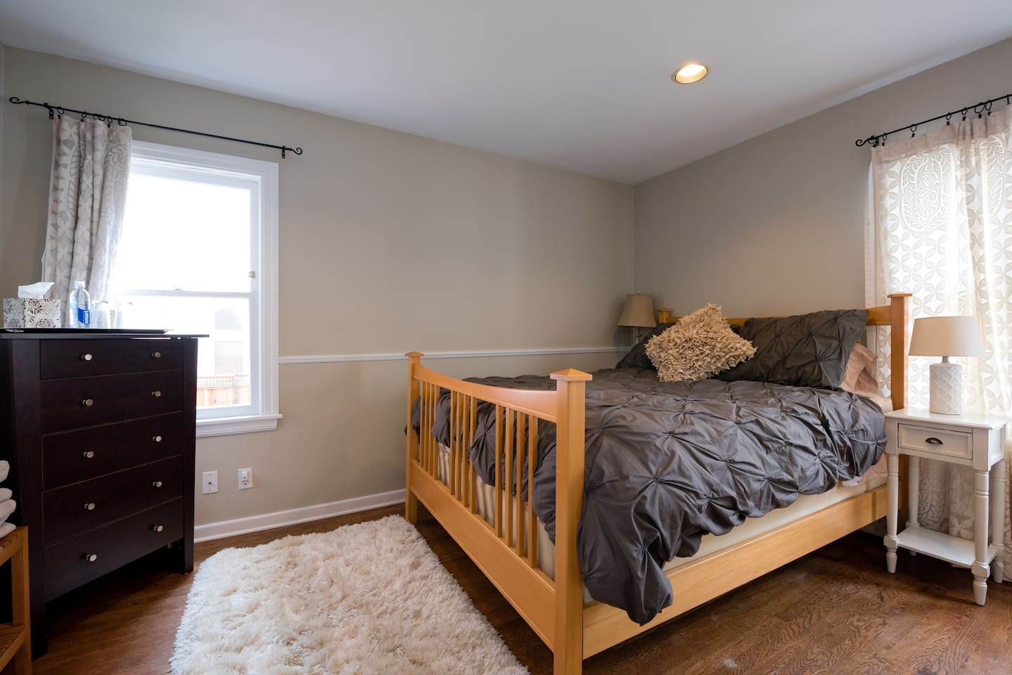 Comfy bed, two side tables with lamps, dresser, large closet!