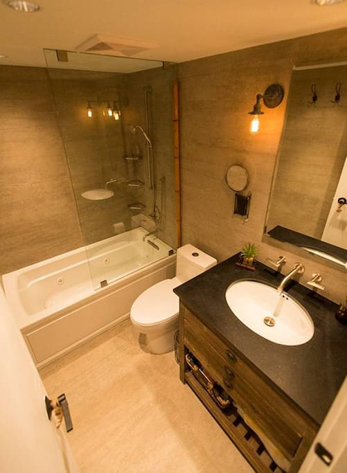 Enjoy this spa like bathroom with jacuzzi tub. The jets move around, so you can make sure you are alining all your right spots that ache or just need extra TLC. You will feel so relaxed, afterwards..