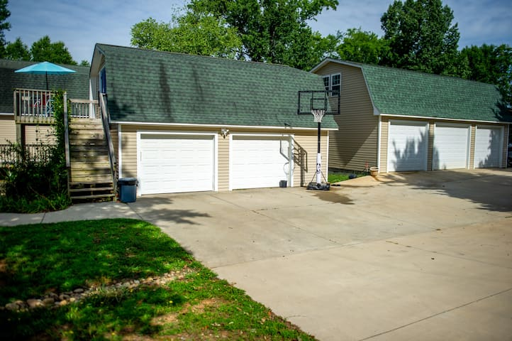 The Guest house is up the stairs,above the garage.  This is where you can park or shoot a few hoops.