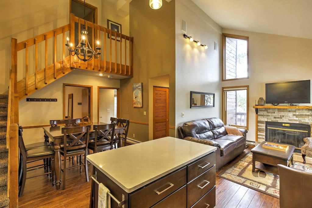 The home's open concept layout offers vaulted ceilings and hardwood floors.