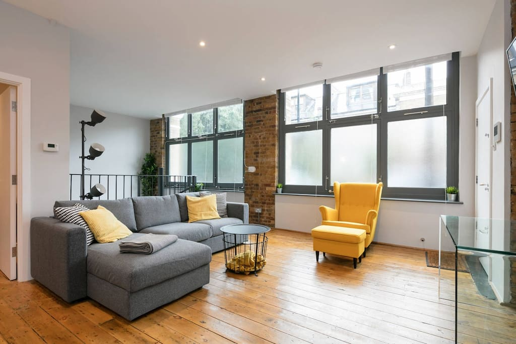Large modern living room with plenty of sunlight