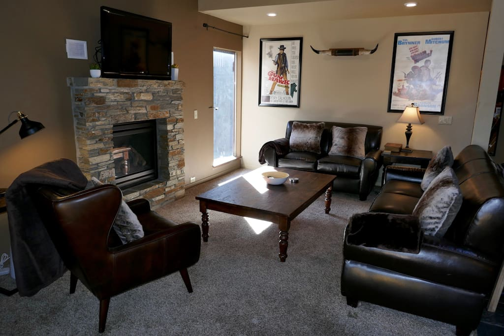 Living room, flat screen with cable and Amazon Fire IP TV, hi speed wireless throughout, gas fireplace.  Sofa, love seat and armchair.