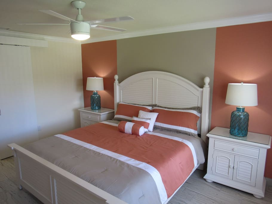 Master bedroom with king size bed and night stands