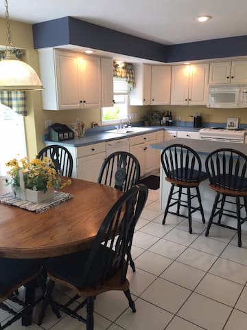 Open kitchen with plenty of seating.