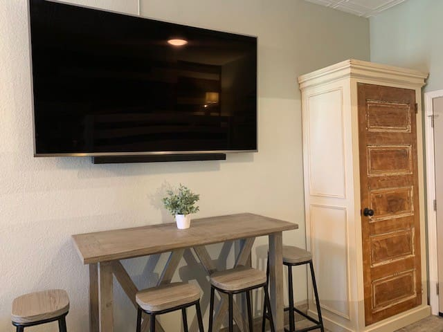 Large Tv that can be easily viewed from both beds