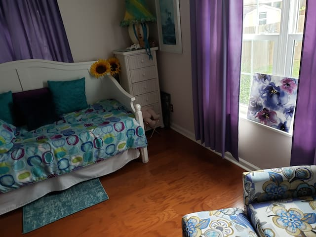 Bedroom #4 with day bed and air mattresses, baby cot and pack n play.