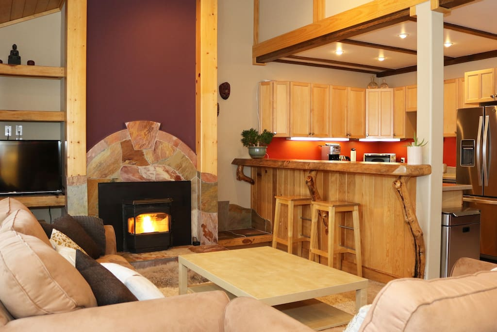 The living room area - pellet stove, bar and kitchen