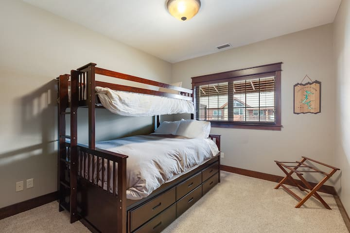 2nd bedroom offers queen bed and a twin XL on the top;  trundle below offering flexible sleeping arrangements if needed or comfortable sleeping for 2.