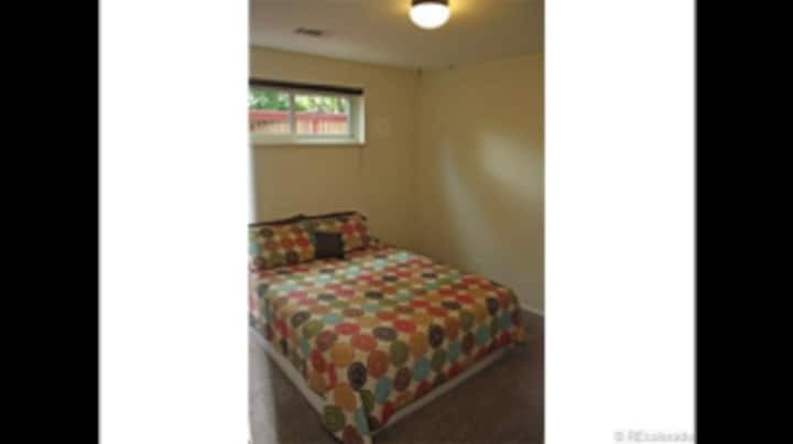 Furnished basement room with queen sized bed.
