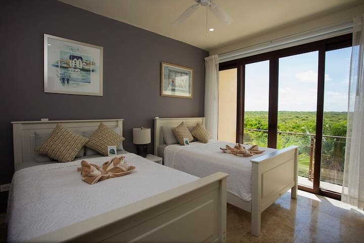 2nd room with two Double beds with a balcony facing the jungle (amazing sunset views)