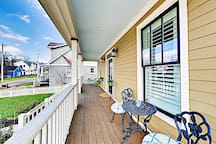 The covered front porch offers more seating to enjoy fresh air.