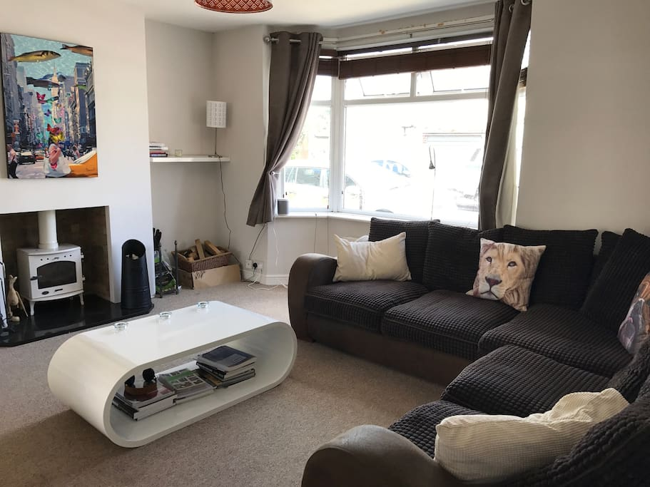 Large airy front room with wood burner and large comfy corner sofa