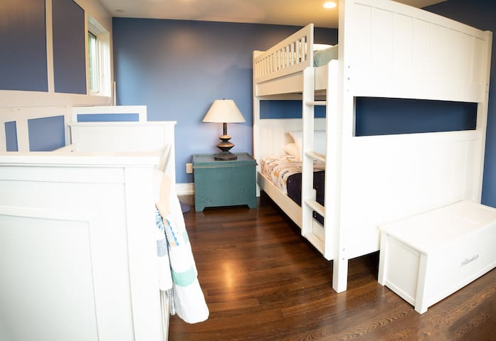 Attached to the master bedroom -- separated by french doors -- the nursery is perfect for small children.  It has a pair of full-sized bunk beds and a crib that can be pulled out if necessary.  We also have a box of toys for kids.   SECOND FLOOR