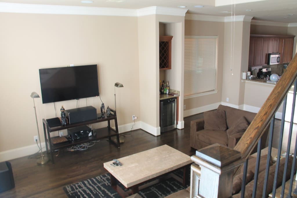 Living room with Smart TV and surround sound. Also Apple TV connected with Netflix