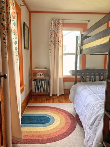 The Woodstock Room is small but conceived with kids in mind. Vivid colors, musical overhead light, electric keyboard, twin bunk bed w/ trundle & record player with a selection of classics (Not all but that's what parents record collections are for).
