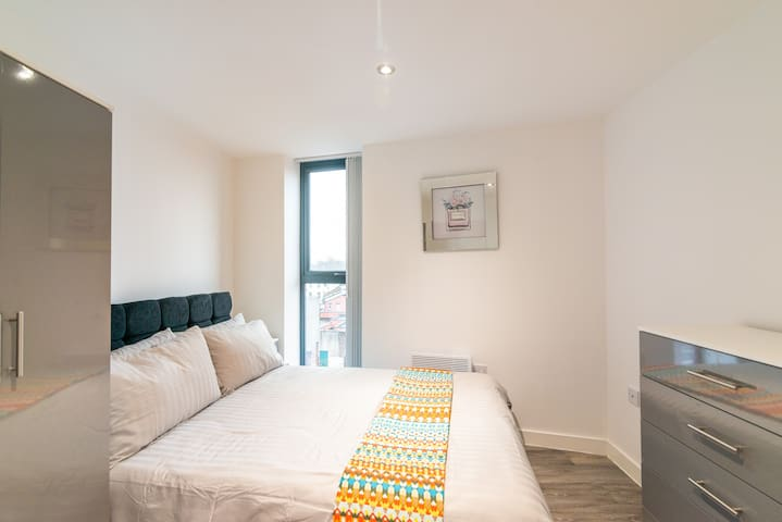Bedroom one sleeps three people  It has a double bed and a single bed separated by a wardrobe. It has super soft and stylish bed linen . Bedroom one has an en-suite bathroom.
