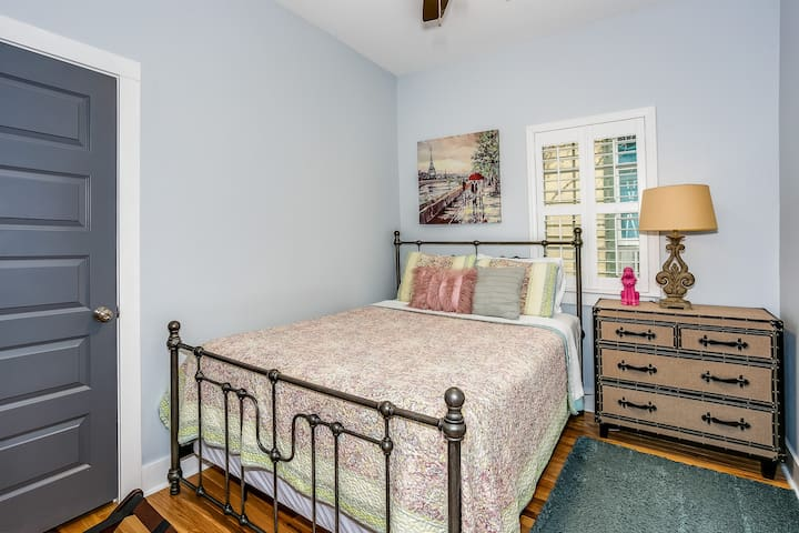 Second bedroom with premium queen mattress, chest of drawers and closet.
