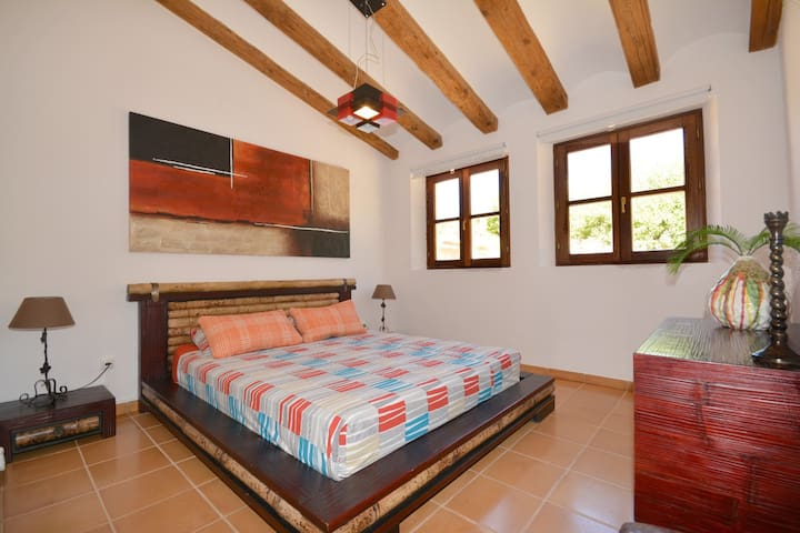 Bedroom with private bathroom and airconditioning/heating.